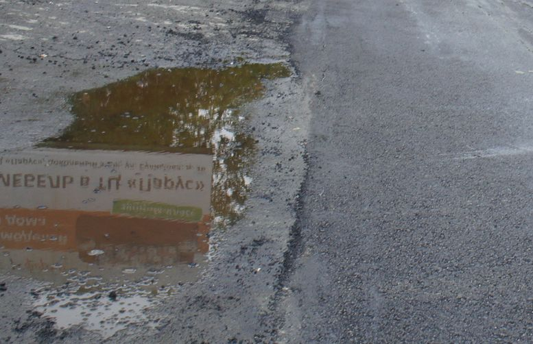 Город не заплатит ни копейки за асфальт, уложенный под дождем